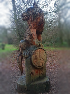 """What's the time Mr. Wolf?!"" ...Wood carving from Tree Fest that takes place in the arboretum over the summer months."